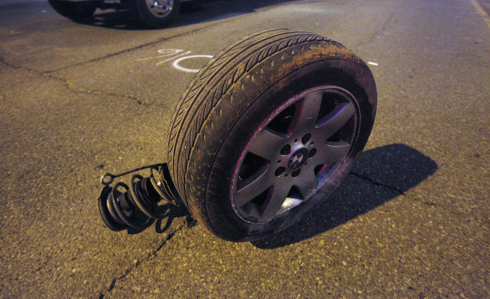 A tire from a BMW lies in the road after an altercation between the occupants in two vehicles resulted in a fatality accident Friday at Northwest Expressway and Wilshire Boulevard in Oklahoma City. Photo by Paul B. Southerland, The Oklahoman <strong>PAUL B. SOUTHERLAND</strong>