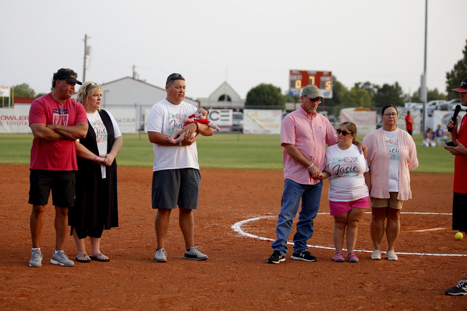 Photo - From left, Chris and Kerry Cochran, their son Cale Cochran with his son Jaxon, Jay and Lea Ann Stephens, with their daughter Stephanie Stephens stand during a presentation ceremony to honor Jacie Stephens Cochran after a softball game in Washington, Okla., Thursday, Sept. 17, 2020. Jacie died July 2 shortly after giving birth to her son Jaxon. [Bryan Terry/The Oklahoman]