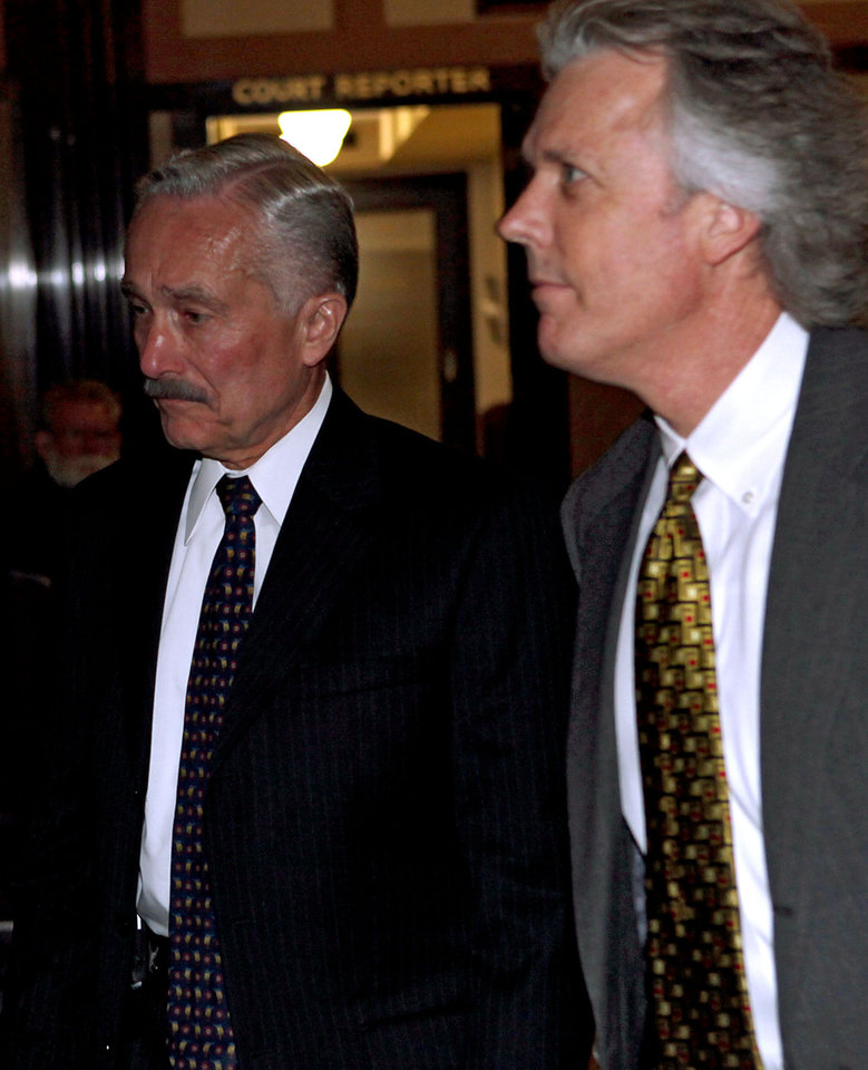 Photo - Oklahoma State Board of Health Member Haskell Evans (left) and his attorney Mack Martin walk into a Grand Jury hearing at the Oklahoma County Courthouse in Oklahoma City on Wednesday, May 13, 2009.  Photo by John Clanton, The Oklahoman ORG XMIT: KOD