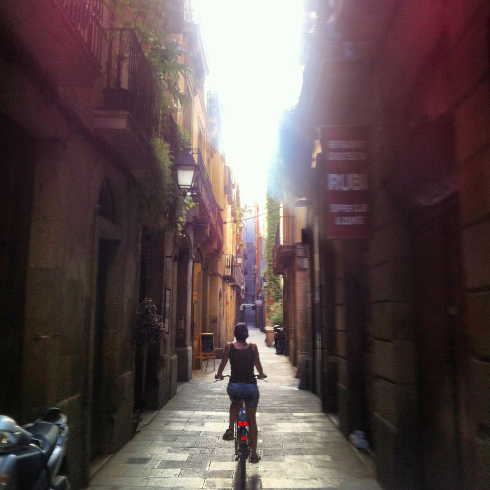 Photo - This undated photo provided by Crystal Cruises shows a woman bicycling on a street in Barcelona, Spain. The elegance of luxury cruising can be combined with active adventures on trips that offer excursions such as bike tours in port. (AP Photo/Crystal Cruises)