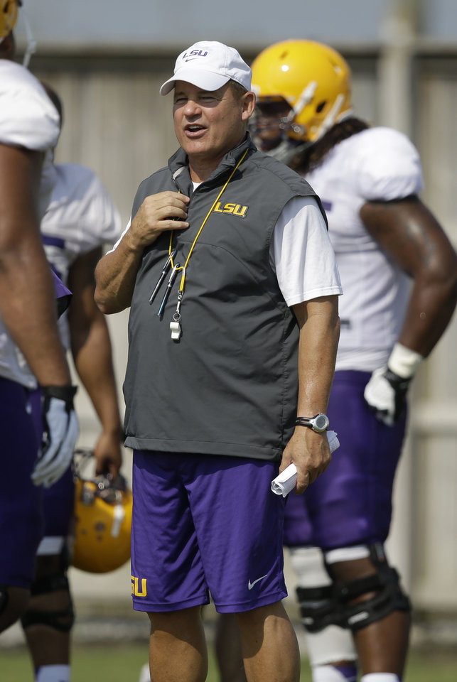 Photo - FILE - In this Aug. 6, 2014, file photo, LSU head coach Les Miles runs drills during their NCAA college football practice in Baton Rouge, La. Miles has yet to announce a starting quarterback and it remains to be seen how much of a role freshman running back Leonard Fournette will have in the offense. (AP Photo/Gerald Herbert, File)