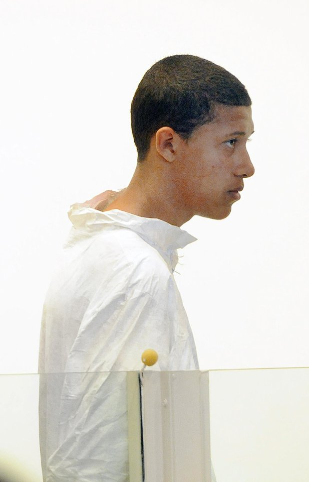 Photo - Philip Chism, 14, stands during his arraignment for the death of Danvers High School teacher Colleen Ritzer in Salem District Court in Salem, Mass., Wednesday, Oct. 23, 2013. Chism has been ordered held without bail. (AP Photo/Boston Herald, Patrick Whittemore) MANDATORY CREDIT