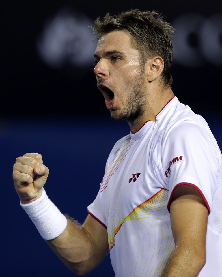 Photo - Stanislas Wawrinka of Switzerland celebrates a point won against  Tomas Berdych of the Czech Republic during their semifinal at the Australian Open tennis championship in Melbourne, Australia, Thursday, Jan. 23, 2014.(AP Photo/Aaron Favila)
