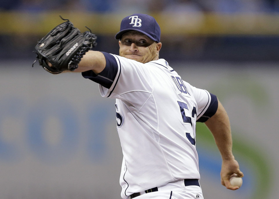 Photo - Tampa Bay Rays starting pitcher Alex Cobb goes into his windup against the Milwaukee Brewers during the first inning of a baseball game Tuesday, July 29, 2014, in St. Petersburg, Fla. (AP Photo/Chris O'Meara)