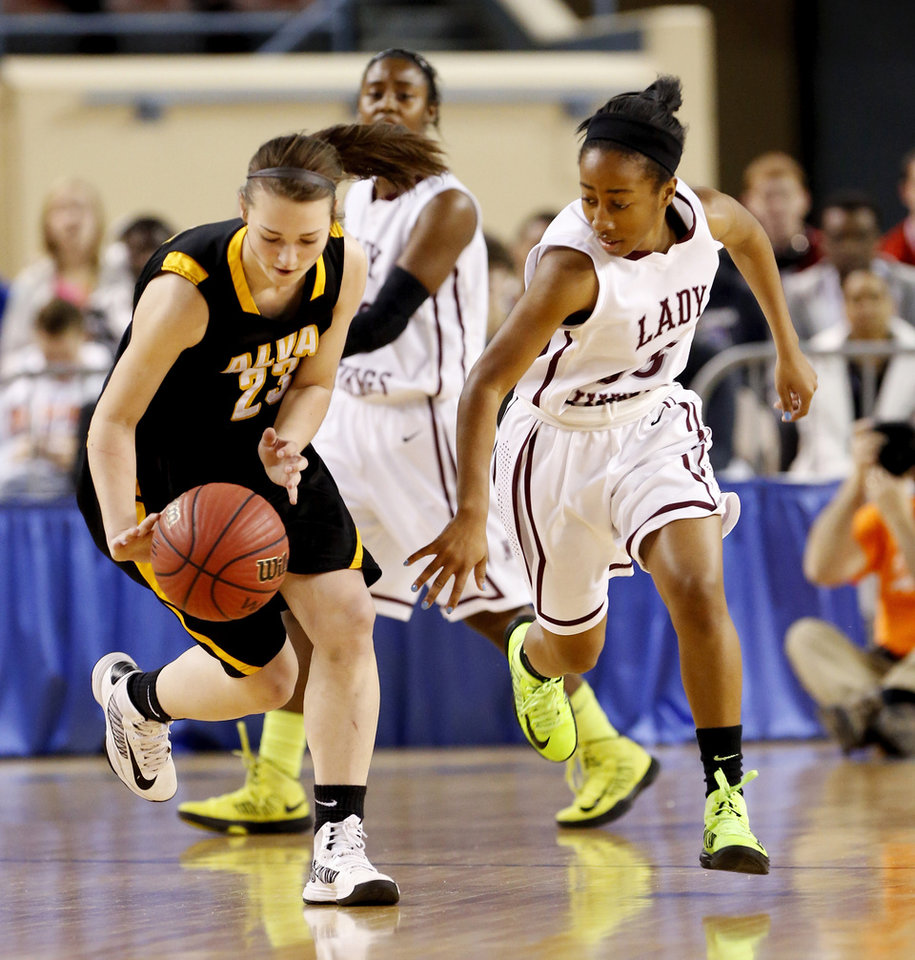 Alva's Jaden Hobbs steals the ball from Latia Robertson during the 2A girls championship game between the Northeast Academy Lady Vikings and the Alva high school Lady Bugs at the State Fair Arena on Saturday, March 9, 2013 in Oklahoma City, Okla.  Photo by Steve Sisney, The Oklahoman