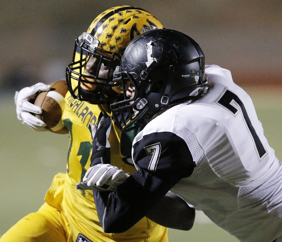 Photo - Mac #11 Davon Finkley is hit by MHS #7 Robby Stephens during the high school football playoff between McAlester and Lawton MacArthur at Choctaw stadium, November 28, 2014. Photo by Doug Hoke, The Oklahoman