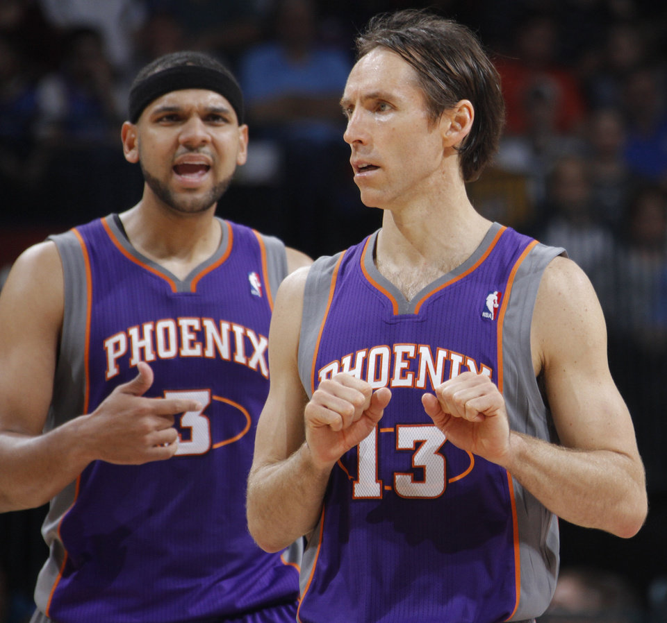 Photo - Phoenix Suns point guard Steve Nash (13) gets the call from the bench as Phoenix Suns small forward Jared Dudley (3) looks on during the NBA basketball game between the Oklahoma City Thunder and the Phoenix Suns at the Chesapeake Energy Arena on Wednesday, March 7, 2012 in Oklahoma City, Okla.  Photo by Chris Landsberger, The Oklahoman