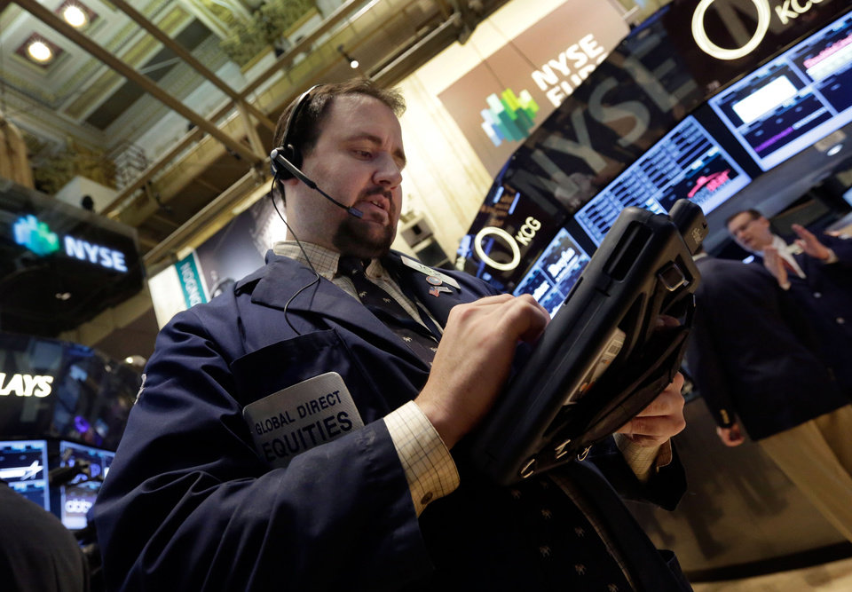 Photo - Trader Michael Mozian works on the floor of the New York Stock Exchange Monday, July 22, 2013.  The stock market edged higher as a big week of earnings kicked off Monday.   (AP Photo/Richard Drew)