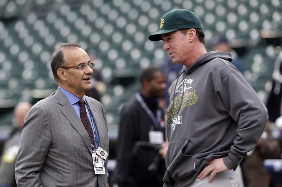 Photo -   Executive Vice President for Baseball Operations for Major League Baseball, Joe Torre, left, talks with Oakland Athletics manager Bob Melvin before Game 1 of the American League division baseball series against the Detroit Tigers, Saturday, Oct. 6, 2012, in Detroit. (AP Photo/Paul Sancya)