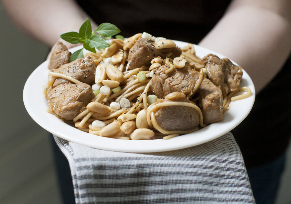 Photo - Kung pao pork with peanuts and scallions  isn't authentic Chinese, but it is quick and delicious. AP Photo  Matthew Mead