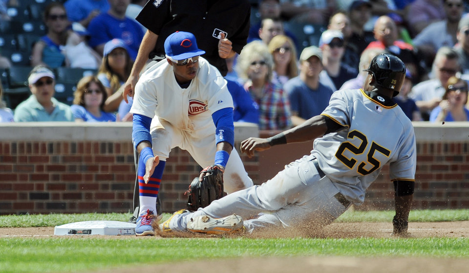 Photo - Chicago Cubs third baseman Luis Valbuena makes a tag on Pittsburgh Pirates right fielder Gregory Polanco during the eighth inning of a baseball game on Sunday, June 22, 2014, in Chicago. (AP Photo/Matt Marton)