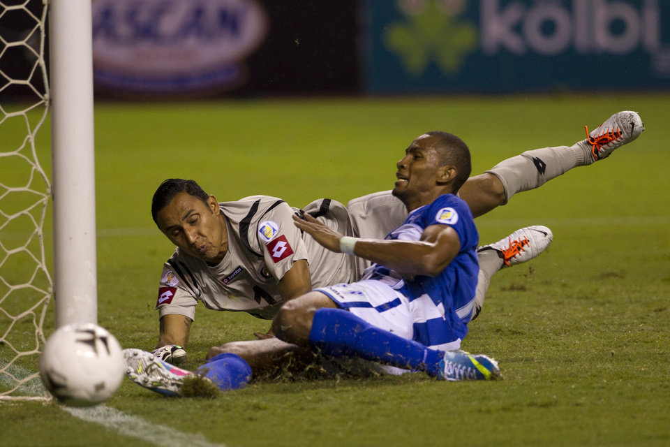 Photo - FILE - In this June 7, 2013, file photo, Honduras' Jerry Bengtson misses a chance to score against Costa Rica's goalkeeper Keilor Navas during a 2014 World Cup qualifying soccer match in San Jose, Costa Rica. The Costa Rican squad will face Uruguay, England and Italy in the northeastern city of Fortaleza. (AP Photo/Moises Castillo, File)