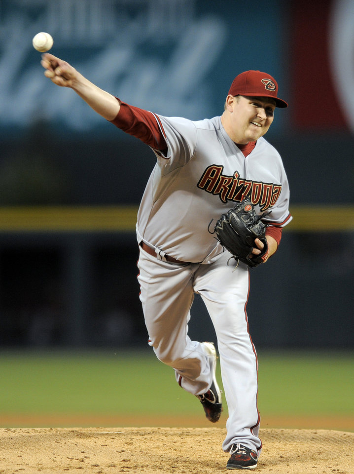 Photo -   Arizona Diamondbacks starting pitcher Trevor Cahill throws against the Colorado Rockies during the first inning of a baseball game, Monday, Sept. 24, 2012, in Denver. (AP Photo/Jack Dempsey)