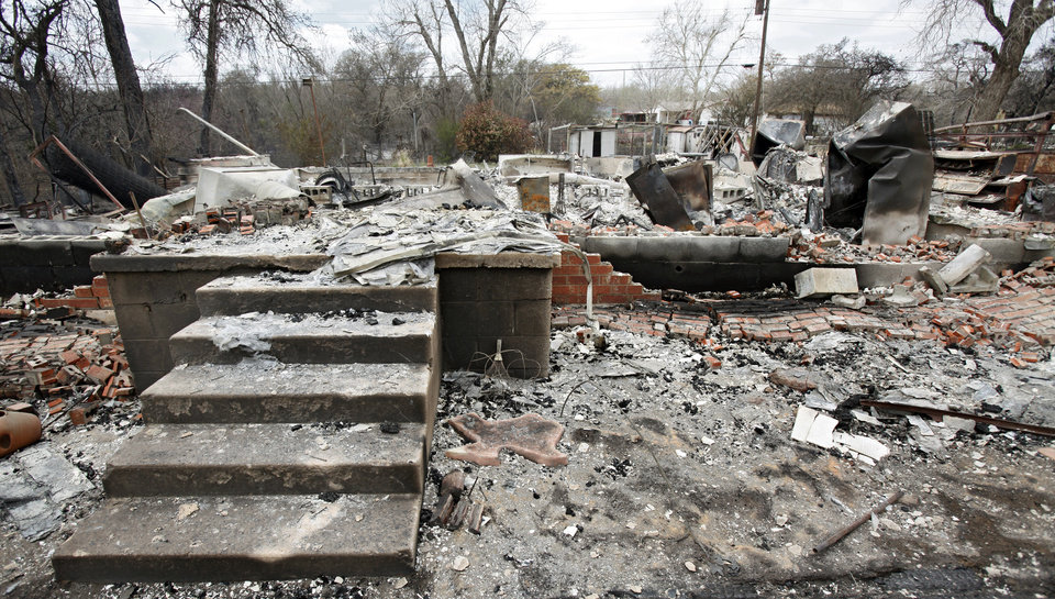 Concrete steps remain at a house that was destroyed by wildfires on Friday, April 10, 2009, in Choctaw, Okla.  Photo by Chris Landsberger, The Oklahoman