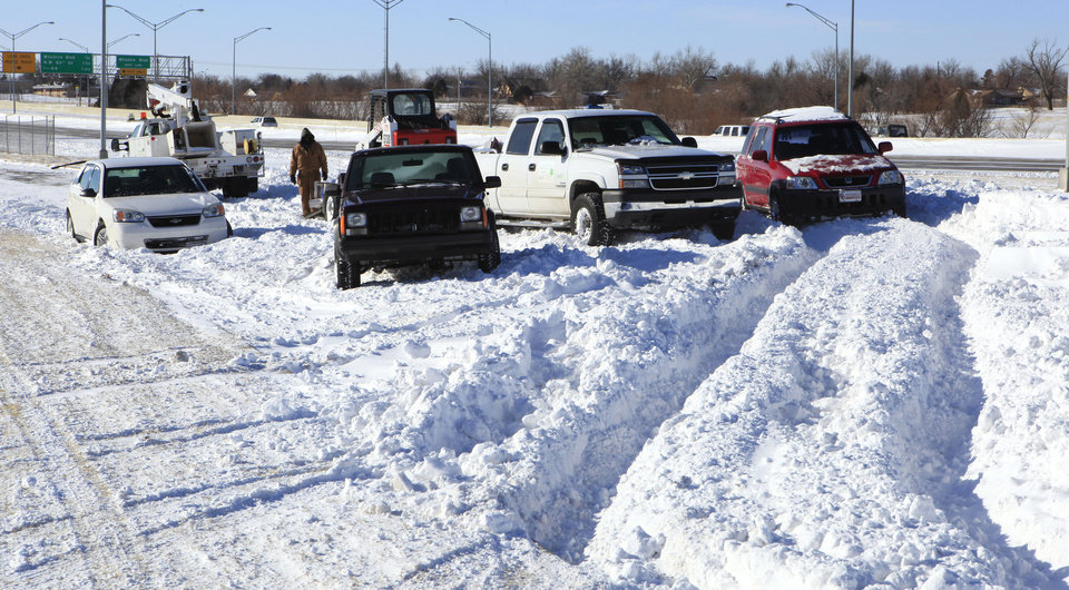 Photo - Vehicles stuck at the Britton Road northbound off ramp of the Broadway Extension Wednesday, Feb. 2, 2011. Seven vehicles were stuck there preventing snow plows from clearing the area of large snow drifts. Photo by Paul B. Southerland, The Oklahoman