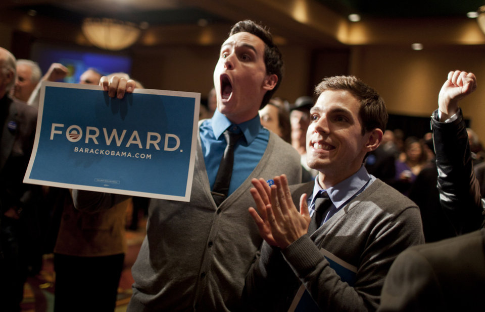 New Mexico Democrats including Clint Milhollin, left, and his boyfriend Will Toledo, celebrate at the Embassy Suites Tuesday, Nov. 6, 2012, in Albuquerque, N.M. (AP Photo/Craig Fritz)