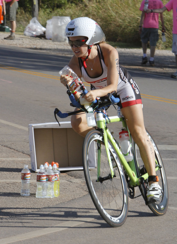 Katie Colville rounds a curve at McArthur and Covell during the Redman Triathlon in Oklahoma City, OK, Saturday, September 22, 2012,  By Paul Hellstern, The Oklahoman