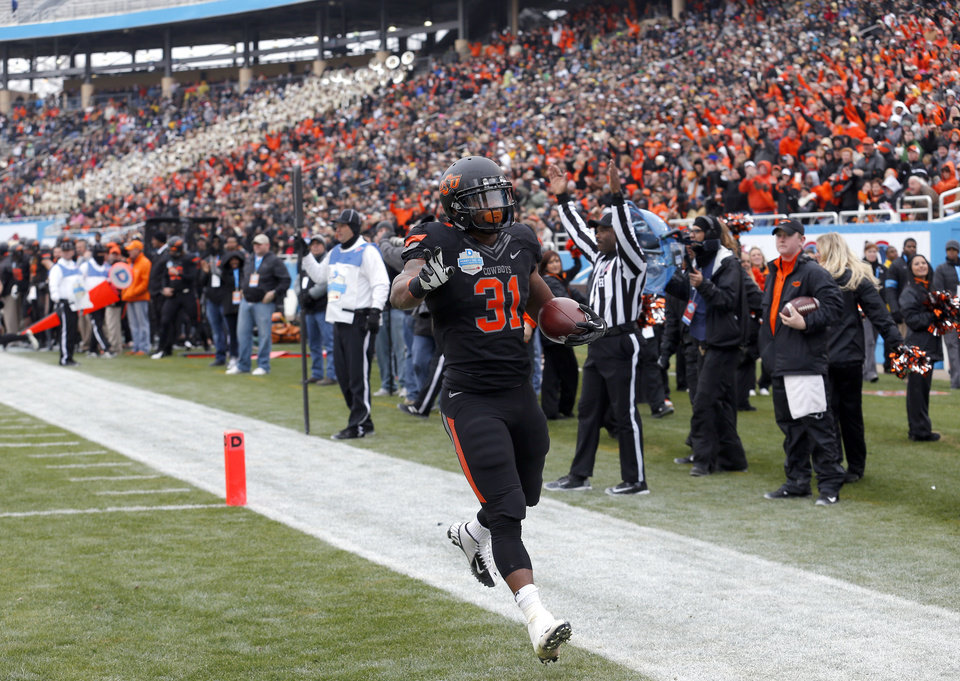 Photo - Oklahoma State's Jeremy Smith (31) scores a touchdown during the Heart of Dallas Bowl football game between the Oklahoma State University (OSU) and Purdue University at the Cotton Bowl in Dallas,  Tuesday,Jan. 1, 2013. Photo by Sarah Phipps, The Oklahoman