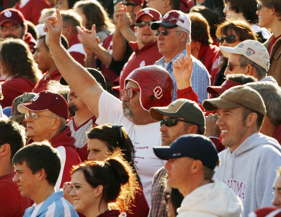 Photo - Fans cheer during the first half of the college football game between the University of Oklahoma Sooners (OU) and the Texas Tech Red Raiders (TTU) at the Gaylord Family Memorial Stadium on Saturday, Nov. 13, 2010, in Norman, Okla.  Photo by Steve Sisney, The Oklahoman