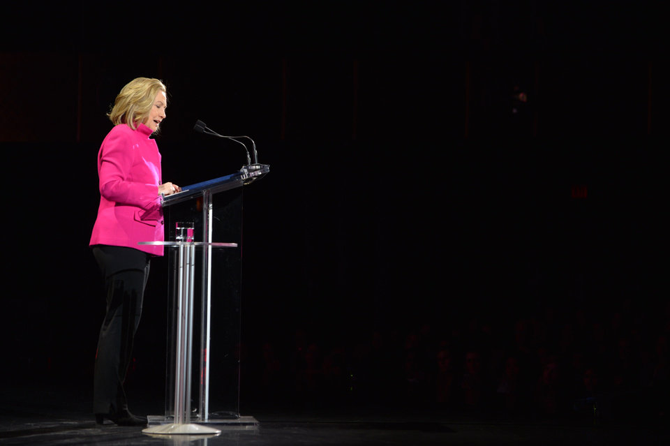 Photo - This image released by Women in the World shows former Secretary of State Hillary Rodham Clinton  speaking at the Women in the World Conference on Friday, April 5, 2013 in New York. Clinton said Friday that the rights of women represent