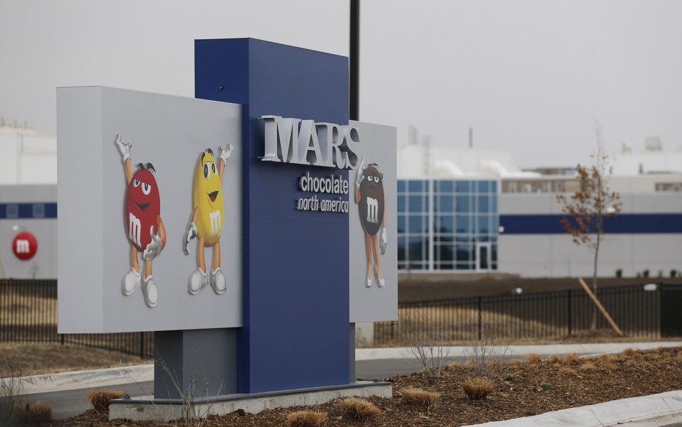 Photo - This Wednesday, March 26, 2014 photograph shows the entrance of the new Mars Inc. production facility near Topeka, Kan. It's the company's first new North American production facility in 35 years. (AP Photo/Orlin Wagner)