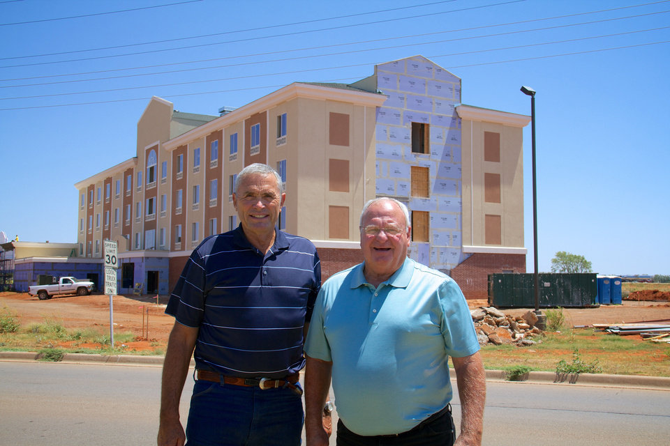 Elk City Commissioners Tom Mike Johnson and Allen Robinson are in front of a new Holiday Inn under construction in Elk City.
