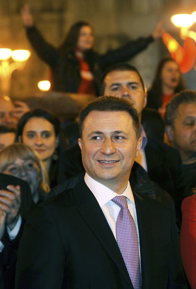 Photo - Macedonian Prime Minister and leader of the ruling conservative VMRO-DPMNE Nikola Gruevski, center, attends a celebration of the party's double victory in parliamentary and presidential elections, in downtown Skopje, Macedonia, early Monday, April 28, 2014. Macedonia's incumbent prime minister claimed a landslide victory late Sunday in parliamentary and presidential elections, but the center-left opposition denounced what it called distorting interference in the democratic process by the ruling party and said it won't recognize the results. (AP Photo/Boris Grdanoski)