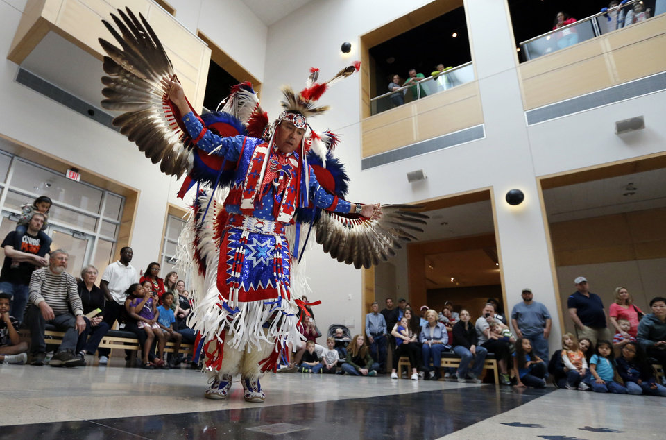 Photo -  Kevin Connywerdy does an eagle dance as the Oklahoma Fancy Dancers perform at the Sam Noble Oklahoma Museum of Natural History. PHOTO BY STEVE SISNEY, THE OKLAHOMAN   STEVE SISNEY -