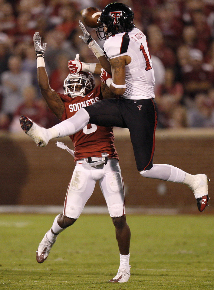 Oklahoma's Demontre Hurst (6) deflects a pass intended for Texas Tech's Darrin Moore (14) during the college football game between the University of Oklahoma Sooners (OU) and the Texas Tech University Red Raiders (TTU) at Gaylord Family-Oklahoma Memorial Stadium in Norman, Okla., Saturday, Oct. 22, 2011. Photo by Bryan Terry, The Oklahoman