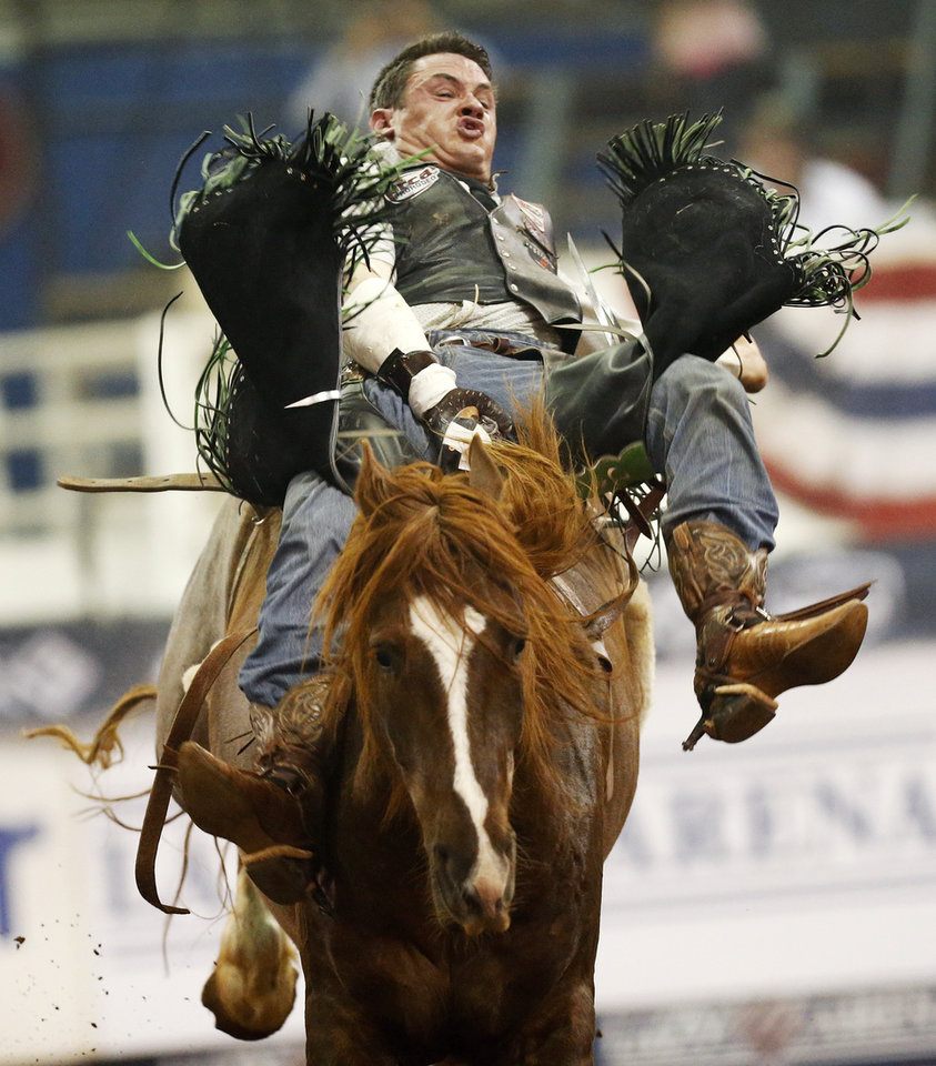 Photo - Brian Leddy of Roll, Okla., competes in bareback riding during the National Circuit Finals Rodeo at the Lazy E Arena in Guthrie, Okla., Saturday afternoon, April 12, 2014. Photo by Nate Billings, The Oklahoman