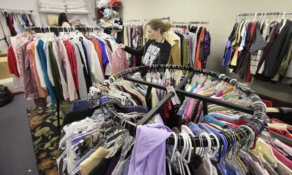 Photo -  Debbie Ashford of Edmond, director of No Boundaries International's Carina's Closet, sorts through donated clothing at the clothing distribution site. Photo by Paul B. Southerland, The Oklahoman       PAUL B. SOUTHERLAND -  PAUL B. SOUTHERLAND