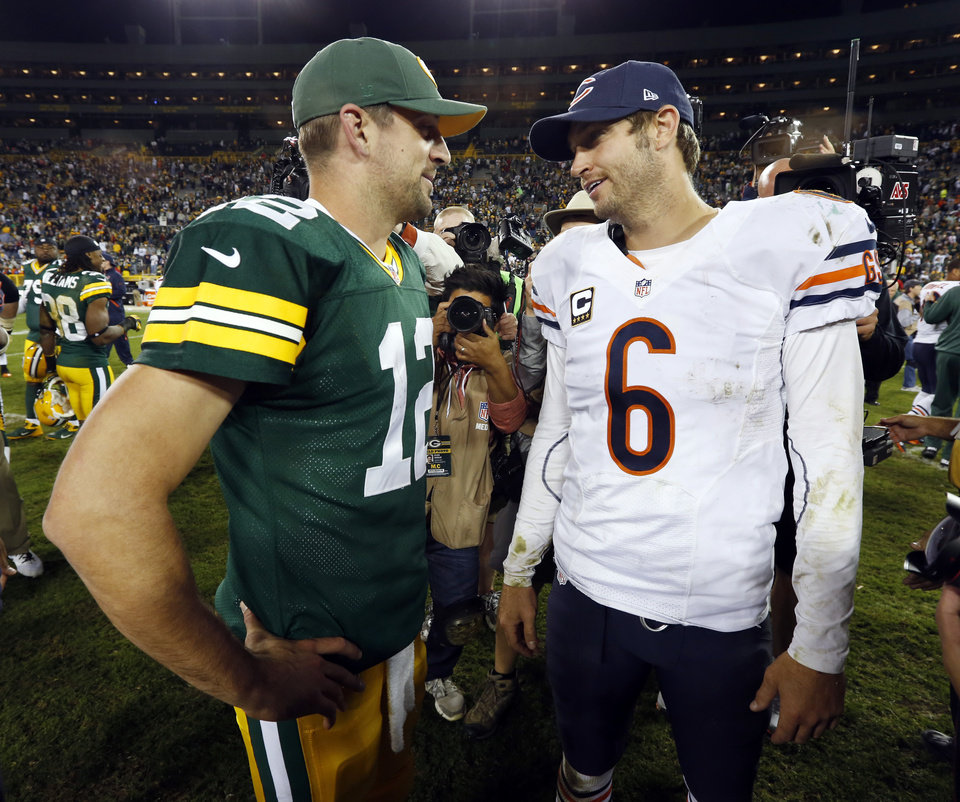 Photo -   Green Bay Packers' Aaron Rodgers (12) talks to Chicago Bears' Jay Cutler (6) after the second half of an NFL football game Thursday, Sept. 13, 2012, in Green Bay, Wis. The Packers won 23-10. (AP Photo/Mike Roemer)