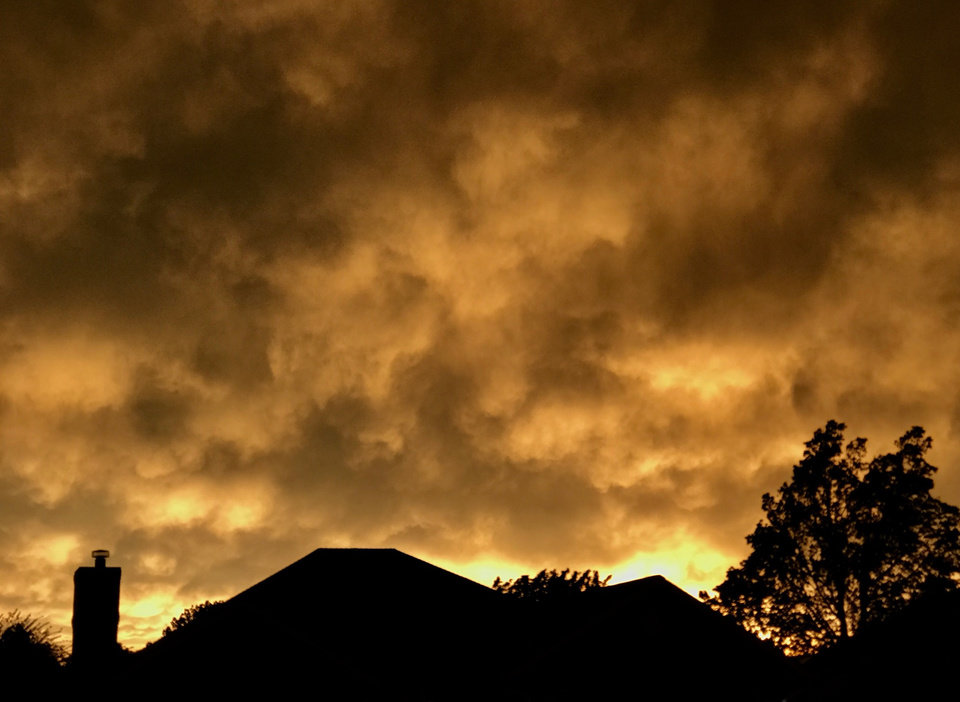 Photo - Storm clouds at sunset in the Midwest City area. These clouds were accompanied by powerful winds as they passed over eastern Oklahoma County. Photo by Jim Beckel/ The Oklahoman
