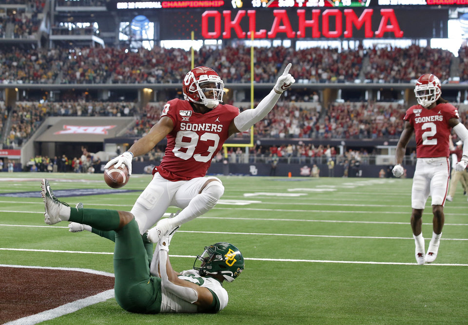 Photo - Oklahoma's Nick Basquine (83) celebrates over Baylor's JT Woods (22) after scoring s touchdown during the Big 12 Championship Game between the University of Oklahoma Sooners (OU) and the Baylor University Bears at AT&T Stadium in Arlington, Texas, Saturday, Dec. 7, 2019. Oklahoma won 30-23. [Bryan Terry/The Oklahoman]