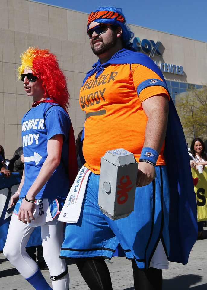 Photo - Thunder fans Dalton Miller, left, and Jake Keel walk through Thunder Alley before Game 2 in the first round of the NBA playoffs between the Oklahoma City Thunder and the Houston Rockets at Chesapeake Energy Arena in Oklahoma City, Wednesday, April 24, 2013. The pair do not have tickets and are hoping to win the pre-game ticket drawing. They won tickets in the drawing for Game 1 last Sunday. Photo by Nate Billings, The Oklahoman