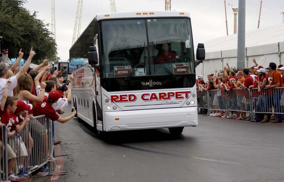 Photo - OU fans cheer for the team bus as it arrives before the Red River Rivalry college football game between the University of Oklahoma Sooners and the University of Texas Longhorns at the Cotton Bowl Stadium in Dallas, Saturday, Oct. 12, 2013. Photo by Bryan Terry, The Oklahoman