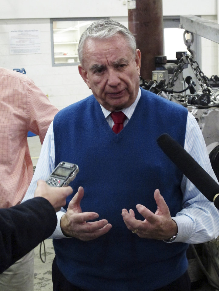 Photo -   Republican U.S. Senate candidate Tommy Thompson takes questions during a stop at Wingra Stone on Friday, Nov. 2, 2012, in Madison, Wis. Thompson faces Democrat Tammy Baldwin in the race to fill Wisconsin's open Senate seat. (AP Photo/Scott Bauer)