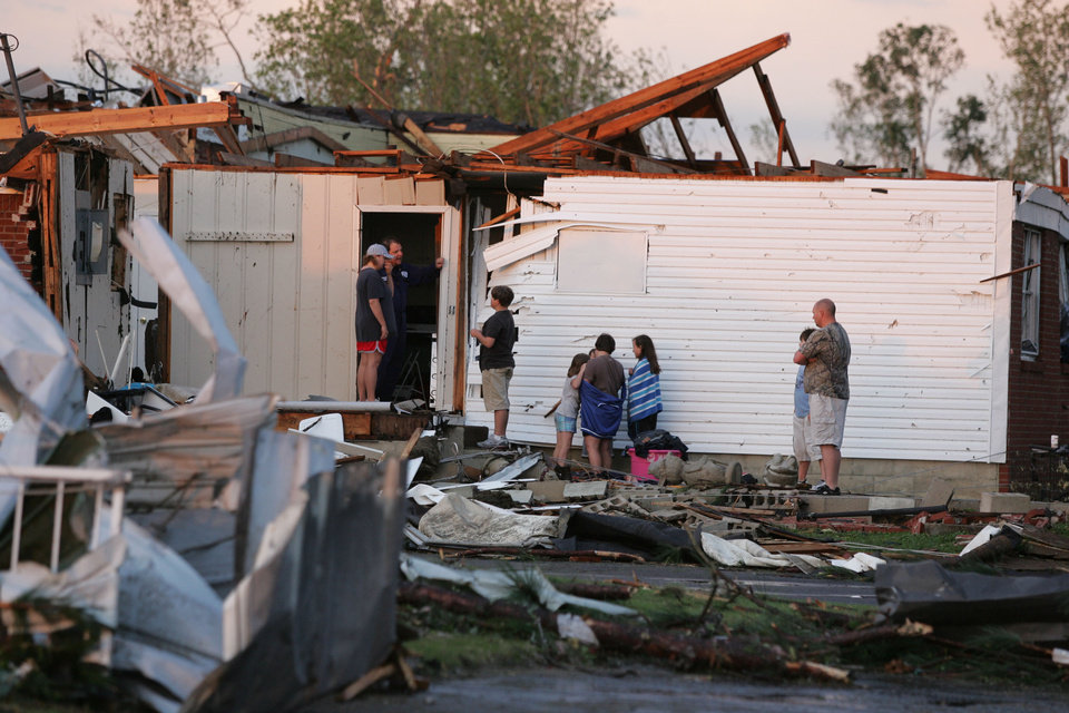 Photo - Residents gather following a tornado, Wednesday, April 27, 2011 in Smithville, Miss.(AP Photo, Northeast Mississippi Daily Journal, Thomas Wells)