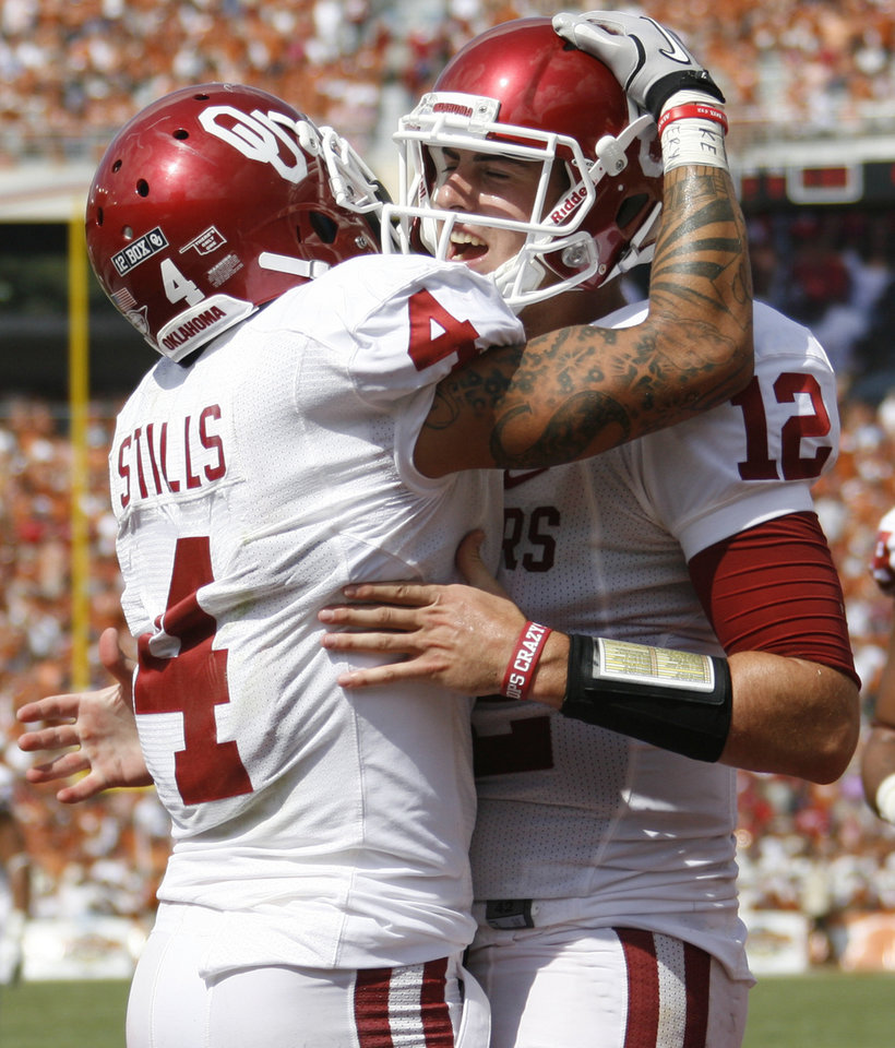 Oklahoma's Landry Jones (12) celebrates with Oklahoma's Kenny Stills (4) during the Red River Rivalry college football game between the University of Oklahoma Sooners (OU) and the University of Texas Longhorns (UT) at the Cotton Bowl in Dallas, Saturday, Oct. 8, 2011. Photo by Bryan Terry, The Oklahoman