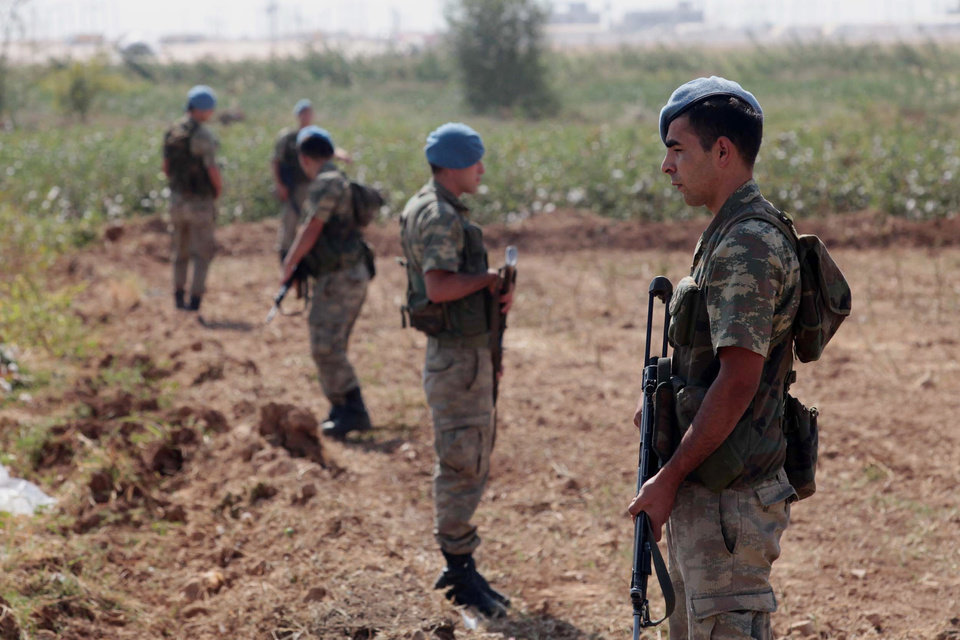 Turkish commandos stand near the Turkey-Syria border in Akcakale, Turkey, Thursday, Oct. 4, 2012. Turkey fired on Syrian targets for a second day Thursday, but said it has no intention of declaring war, despite tensions after deadly shelling from Syria killed five civilians in a Turkish border town.(AP Photo)