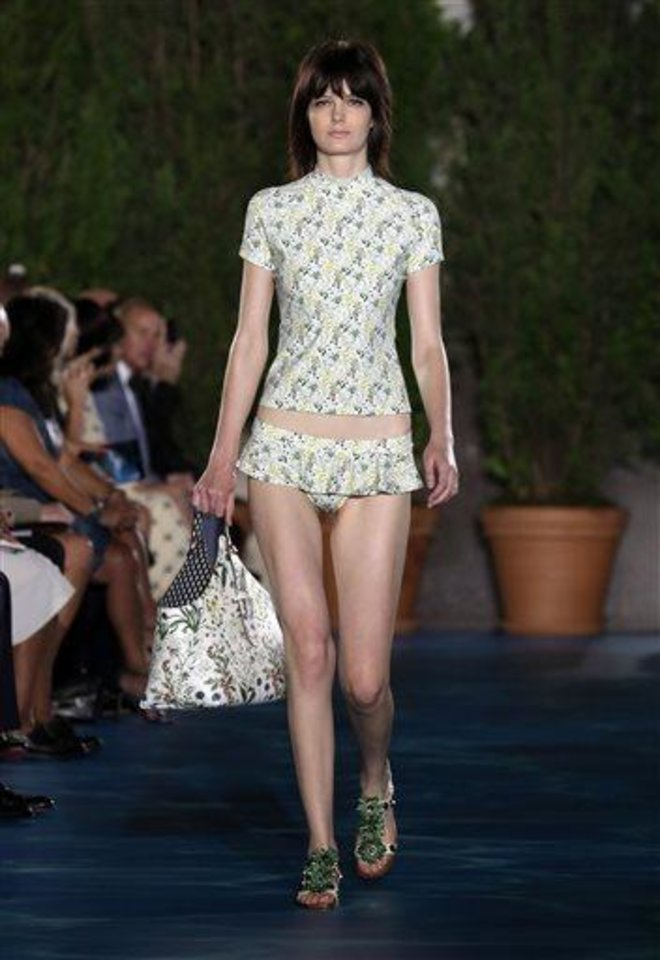 Photo -  The Tory Burch Spring 2014 collection is modeled during Fashion Week in New York,  Tuesday, Sept. 10, 2013. (AP Photo/Richard Drew)