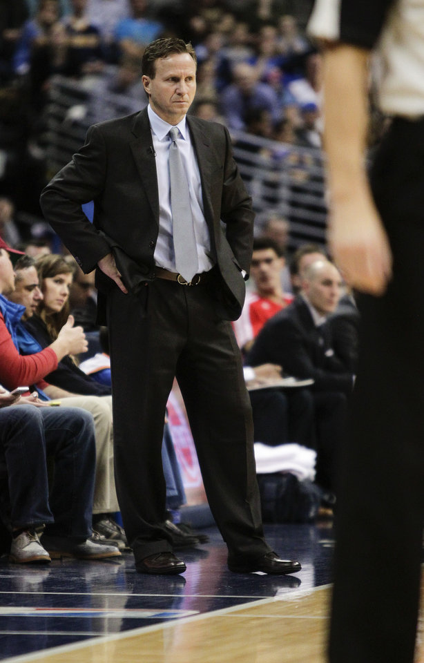 Photo - Oklahoma City Thunder head coach Scott Brooks stands on the sideline during the first quarter of an NBA basketball game against the Denver Nuggets, Thursday, Jan. 9, 2014, in Denver. (AP Photo/Barry Gutierrez)