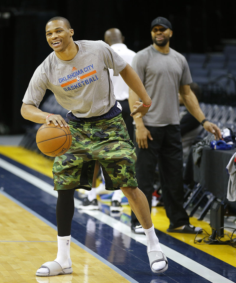 Photo - Oklahoma City's Russell Westbrook laughs as h dribbles at the end of practice at FedExForum in Memphis, Tenn., Friday, April 25, 2014. The Oklahoma City Thunder will play the Memphis Grizzlies in Game 4 during the first round of NBA playoffs on Saturday, April 26, 2014. PHOTO BY BRYAN TERRY, The Oklahoman