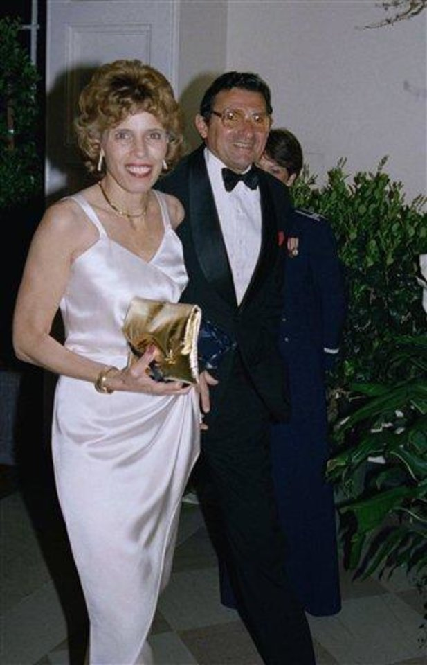 Photo - Penn State football coach Joe Paterno, right, and his wife Suzanne Paterno arrive for a State Dinner at the White House, Tuesday, March 31, 1987, Washington, D.C. The dinner was in honor of Prime Minister and Mrs. Chirac of France. (AP Photo/Dennis Cook)