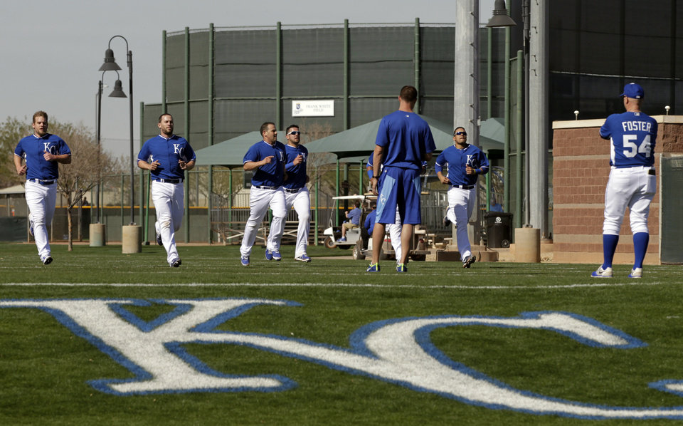 Photo - Kansas City Royals catchers run  during morning workouts at spring training baseball practice, Saturday, Feb. 15, 2014, in Surprise, Ariz. (AP Photo/Tony Gutierrez)
