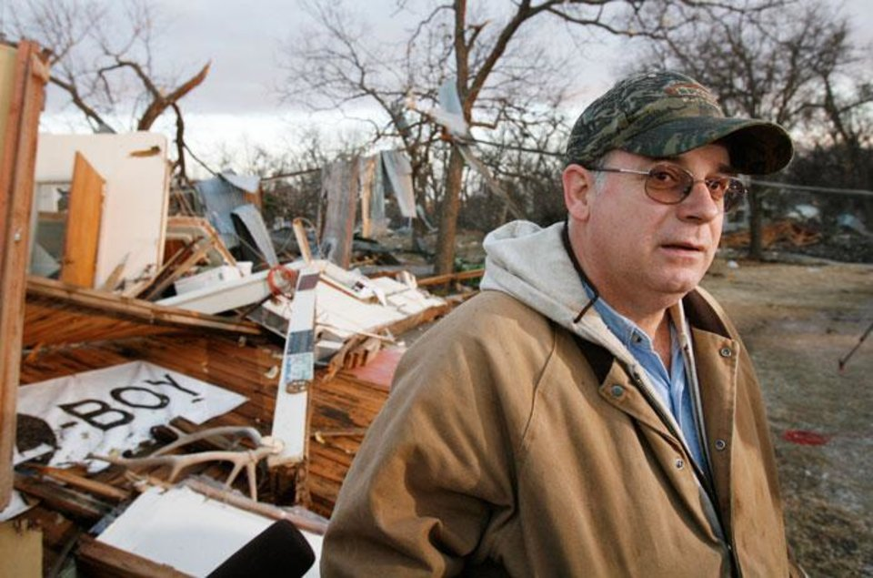 Photo -  John Taliaferro sees the remains of his furniture store in first light after  Tuesday's deadly tornado in  Lone Grove, Okla., on Wednesday, Feb. 11, 2009.   Photo by Steve Sisney, The Oklahoman