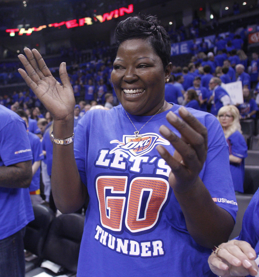 Wanda Pratt, Kevin Durant's mother, celebrates after the Oklahoma City Thunder defeated the Los Angeles Lakers 106-90 in Game 5 in their NBA basketball Western Conference semifinal playoff series, Monday, May 21, 2012, in Oklahoma City. (AP Photo/Sue Ogrocki)