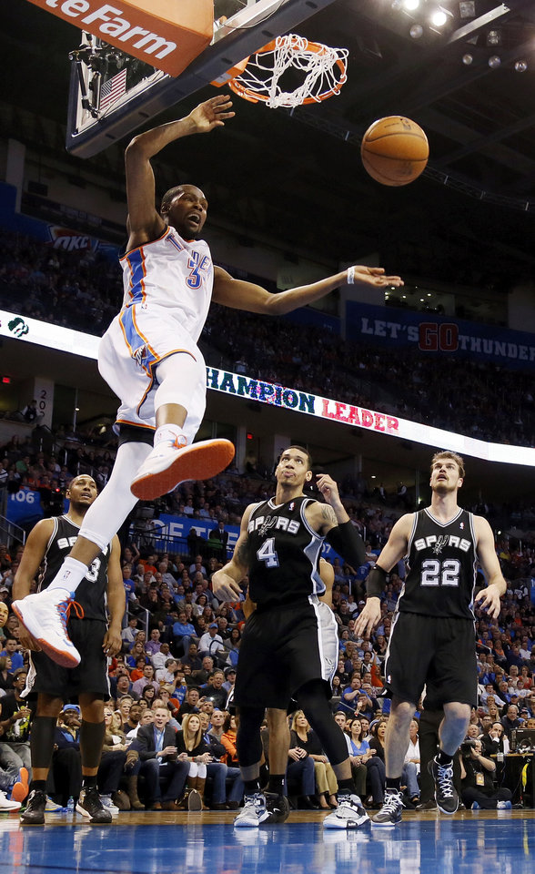 Photo - Oklahoma City's Kevin Durant (35) dunks the ball in front of San Antonio's Boris Diaw (33), Danny Green (4) and Tiago Splitter (22) during an NBA basketball game between the Oklahoma City Thunder and the San Antonio Spurs at Chesapeake Energy Arena in Oklahoma City, Thursday, April 4, 2013. The Thunder won 100-88. Photo by Nate Billings, The Oklahoman