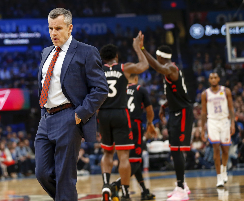 Photo - Oklahoma City coach Billy Donovan walks on the court at the beginning of a timeout as Toronto players high five in the first quarter during an NBA basketball between the Oklahoma City Thunder and the Toronto Raptors at Chesapeake Energy Arena in Oklahoma City, Wednesday, Jan. 15, 2020. [Nate Billings/The Oklahoman]