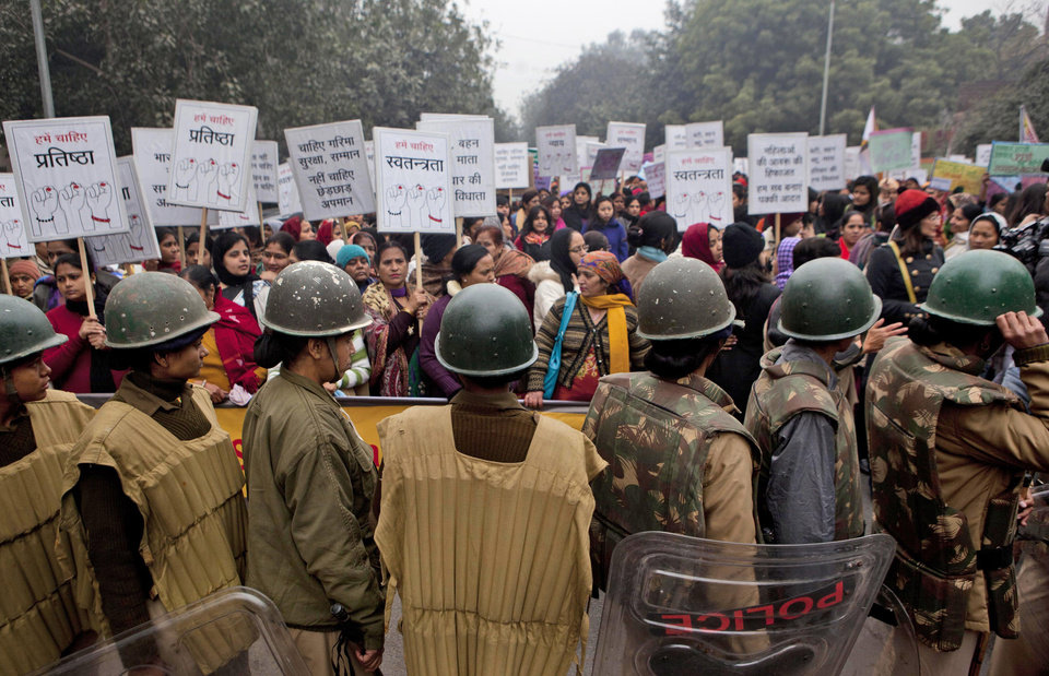 Photo - Indian paramilitary women stand guard during a march to mourn the death of a gang rape victim in New Delhi, India, Wednesday, Jan. 2, 2013. India's top court says it will decide whether to suspend lawmakers facing sexual assault charges as thousands of women gathered at the memorial to independence leader Mohandas K. Gandhi to demand stronger protection for their safety. (AP Photo/ Dar Yasin)